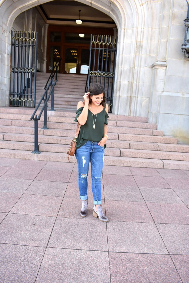 Green off the shoulder top, velvet booties, and distressed jeans